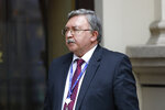 Russia's Governor to the International Atomic Energy Agency (IAEA), Mikhail Ulyanov, has a cigarette break in front of the 'Grand Hotel Wien' where closed-door nuclear talks with Iran take place in Vienna, Austria, Wednesday, May 19, 2021. (AP Photo/Lisa Leutner)