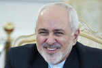 Iranian Foreign Minister Mohammad Javad Zarif smiles during his meeting with Russian Foreign Minister Sergey Lavrov in Moscow, Russia, Wednesday, May 8, 2019. (AP Photo/Pavel Golovkin)