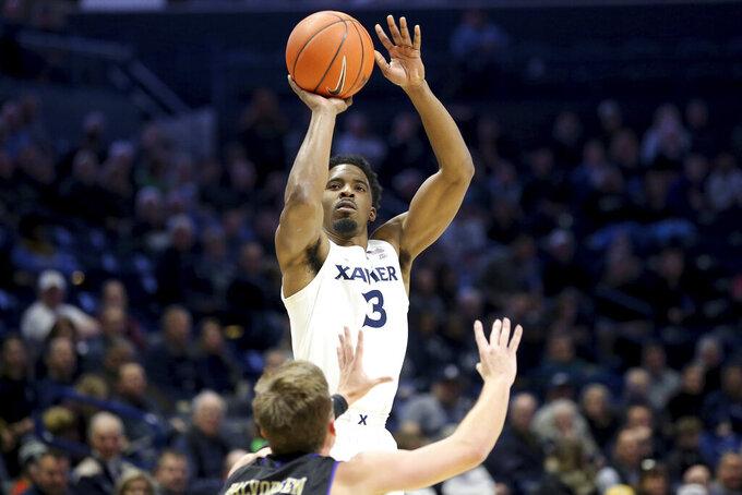 Xavier guard Quentin Goodin (3) rises for a shot during the first half of an NCAA college basketball game against Western Carolina, Wednesday, Dec. 18, 2019 in Cincinnati. (Kareem Elgazzar/The Cincinnati Enquirer via AP)