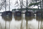 Excessive rains flood the Oktibbeha County Lake campground in Starkville, Miss., Tuesday, Feb. 11, 2020. In eastern Mississippi, officials in Starkville said the water at Oktibbeha County Lake had once again reached a critical level just weeks after heavy rains caused a mudslide that put the earthen dam in danger of failing. (Ryan Phillips/The Starkville Daily News via AP)