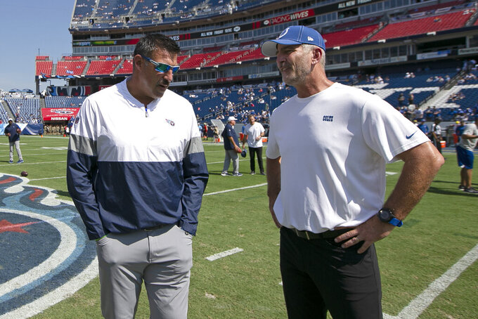 Tennessee Titans head coach Mike Vrabel, left, talks with Indianapolis Colts head coach Frank Reich before an NFL football game Sunday, Sept. 15, 2019, in Nashville, Tenn. (AP Photo/James Kenney)