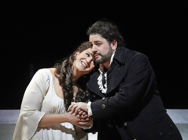 This Nov. 25, 2019 photo released by the Metropolitan Opera, tenor Yusif Eyvazov, right, appears with soprano Lise Davidsen in a scene from Tchaikovsky's