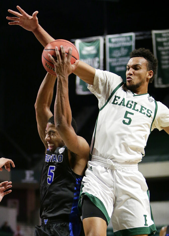 Buffalo guard CJ Massinburg, left, has the ball knocked away by Eastern Michigan forward Elijah Minnie, right, during the first half of an NCAA college basketball game Friday, Jan. 4, 2019, in Ypsilanti, Mich. (AP Photo/Duane Burleson)
