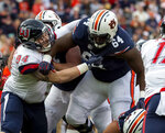Auburn offensive lineman Mike Horton (64) battles Liberty defensive lineman Vincent Elefante (94) during the first half of an NCAA college football game, Saturday, Nov. 17, 2018, in Auburn, Ala. (AP Photo/Vasha Hunt)