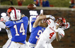 SMU defensive end Turner Coxe (97) forces Houston quarterback D'Eriq King (4) to fumble during the second half of an NCAA college football game Saturday, Nov. 3, 2018, in Dallas. (AP Photo/Brandon Wade)