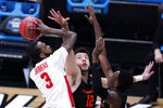 Houston guard DeJon Jarreau (3) shoots on Oregon State center Roman Silva (12) don't know other number on right during the first half of an Elite 8 game in the NCAA men's college basketball tournament at Lucas Oil Stadium, Monday, March 29, 2021, in Indianapolis. (AP Photo/Michael Conroy)