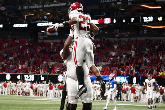 Alabama running back Najee Harris (22) celebrates his touchdown against Florida during the first half of the Southeastern Conference championship NCAA college football game, Saturday, Dec. 19, 2020, in Atlanta. (AP Photo/Brynn Anderson)