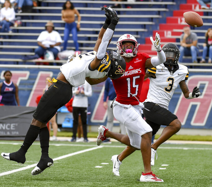 Appalachian State defensive back Steven Jones (12) breaks up a pass intended for South Alabama wide receiver Kawaan Baker (15) during the second half of an NCAA college football game Saturday, Oct. 26, 2019, at Ladd-Peebles Stadium in Mobile, Ala. (AP Photo/Julie Bennett)