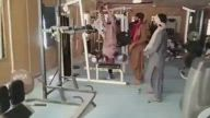 Taliban soldiers work out in presidential palace gym after Kabul takeover