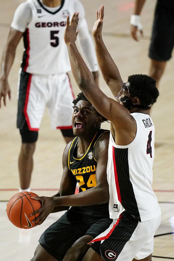 Missouri forward Kobe Brown (24) shoots against Georgia forward Andrew Garcia (4) during the first half of an NCAA college basketball game Tuesday, Feb. 16, 2021, in Athens, Ga. (AP Photo/Brynn Anderson)