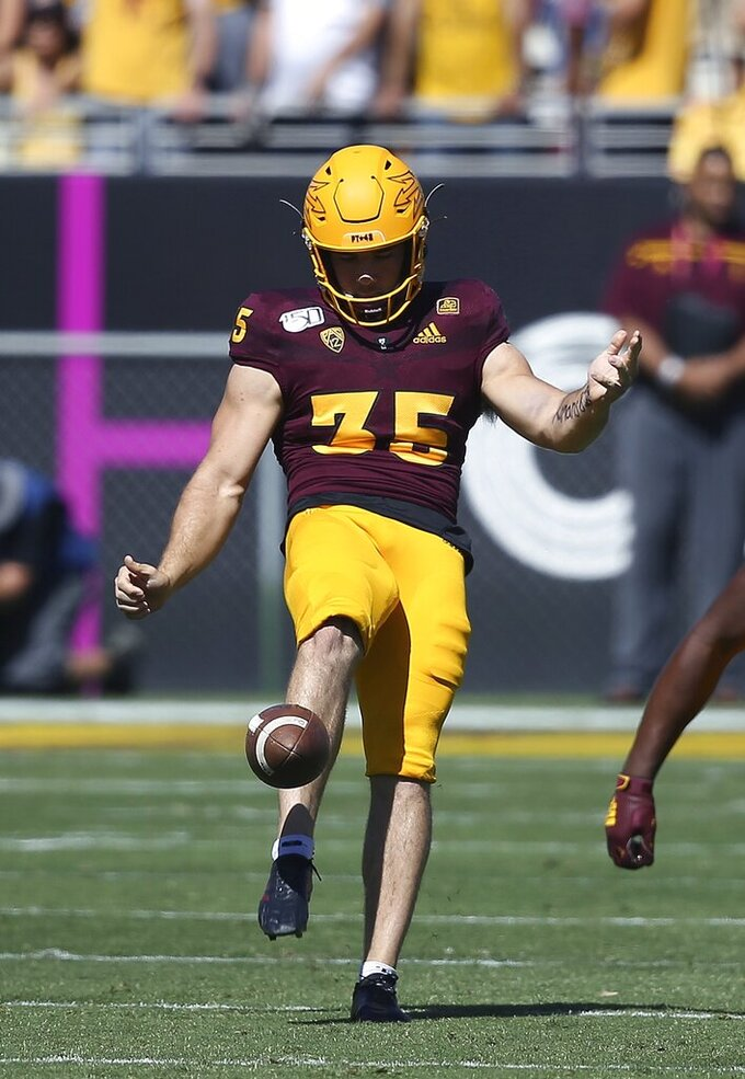 In this Saturday, Oct. 12, 2019, photo, Arizona State punter Michael Turk punts against Washington State during the first half of an NCAA college football game, in Tempe, Ariz. Turk was selected to The Associated Press All-Pac 12 Conference team, Thursday, Dec. 12, 2019. (AP Photo/Ross D. Franklin, File)