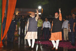 Indian Prime Minister Narendra Modi and Bharatiya Janata Party (BJP) President Amit Shah display the victory symbol to supporters on arrival at the party headquarters in New Delhi, India, Thursday, May 23, 2019. Modi's Hindu nationalist party claimed it won reelection with a commanding lead in Thursday's vote count, while the head of the main opposition party conceded a personal defeat that signaled the end of an era for modern India's main political dynasty. (AP Photo)