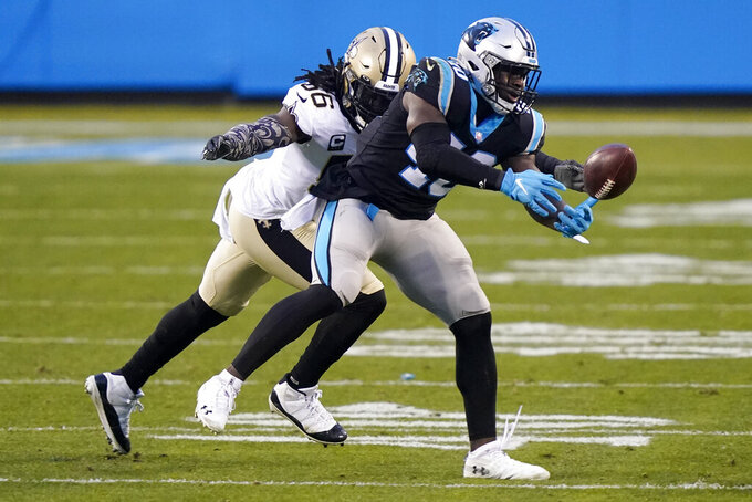 New Orleans Saints outside linebacker Demario Davis breaks up a pass intended for Carolina Panthers fullback Alex Armah during the first half of an NFL football game Sunday, Jan. 3, 2021, in Charlotte, N.C. (AP Photo/Gerry Broome)