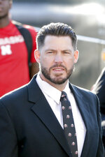 In this Sept. 15, 2018, photo, Nebraska defensive coordinator Erik Chinander arrives to Memorial Stadium in Lincoln, Neb., before an NCAA college football game. Chinander was a Hawkeye through and through as a kid growing up in eastern Iowa and as a walk-on offensive lineman and graduate of Iowa. Now he's a Cornhusker, the defensive coordinator at Nebraska, and he assures everyone he is not conflicted going into the game Friday at Kinnick Stadium in Iowa City. His parents and other family and friends will be there, too, and they'll all be wearing red. (AP Photo/Nati Harnik)