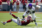 North Carolina State cornerback Nick McCloud (4) tackles East Carolina wide receiver Leroy Henley (10) during the first half of an NCAA college football game in Raleigh, N.C., Saturday, Aug. 31, 2019. (AP Photo/Gerry Broome)
