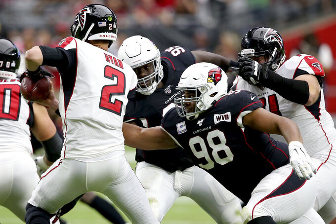 Arizona Cardinals defensive tackle Corey Peters (98) sacks Atlanta Falcons quarterback Matt Ryan (2) during the first half of an NFL football game, Sunday, Oct. 13, 2019, in Glendale, Ariz. (AP Photo/Ross D. Franklin)