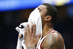 Arkansas forward Reggie Chaney wipes his face in the second half of an NCAA college basketball game against Vanderbilt in the Southeastern Conference Tournament Wednesday, March 11, 2020, in Nashville, Tenn. Arkansas won 86-73. (AP Photo/Mark Humphrey)