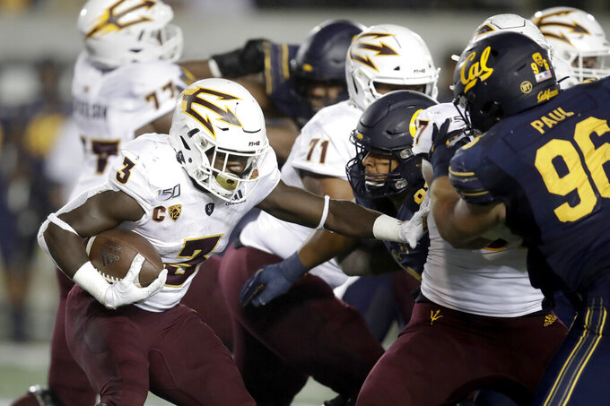 Arizona State's Eno Benjamin (3) runs against California in the second half of an NCAA college football game, Friday, Sept. 27, 2019, in Berkeley, Calif. (AP Photo/Ben Margot)