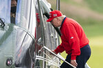 President Donald Trump boards Marine One after playing golf at Trump National Golf Club, Friday, Nov. 27, 2020, in Sterling, Va. (AP Photo/Alex Brandon)