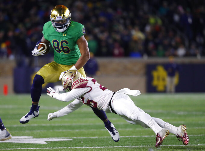 Notre Dame tight end Alize Mack (86) tries to avoid Florida State defensive back Asante Samuel Jr. (26) after a catch in the second half of an NCAA college football game in South Bend, Ind., Saturday, Nov. 10, 2018. (AP Photo/Paul Sancya)