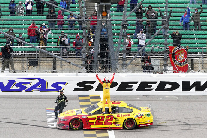Joey Logano celebrates after winning a NASCAR Cup Series auto race at Kansas Speedway in Kansas City, Kan., Sunday, Oct. 18, 2020. (AP Photo/Orlin Wagner)