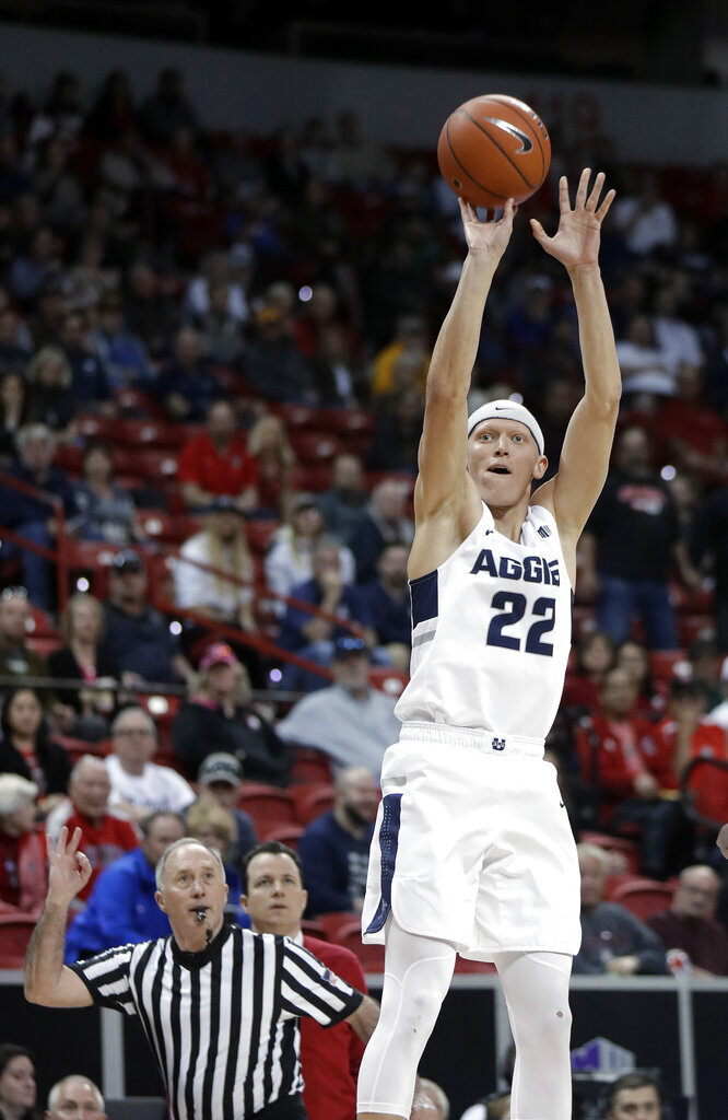 Utah State's Brock Miller (22) shoots a 3-pointer during the first half of an NCAA college basketball game against New Mexico in the Mountain West Conference men's tournament Thursday, March 14, 2019, in Las Vegas. (AP Photo/Isaac Brekken)