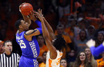 Kentucky forward PJ Washington (25) shoots over Tennessee forward Yves Pons (35) during the first half of an NCAA college basketball game Saturday, March 2, 2019, in Knoxville, Tenn. (AP Photo/Wade Payne)