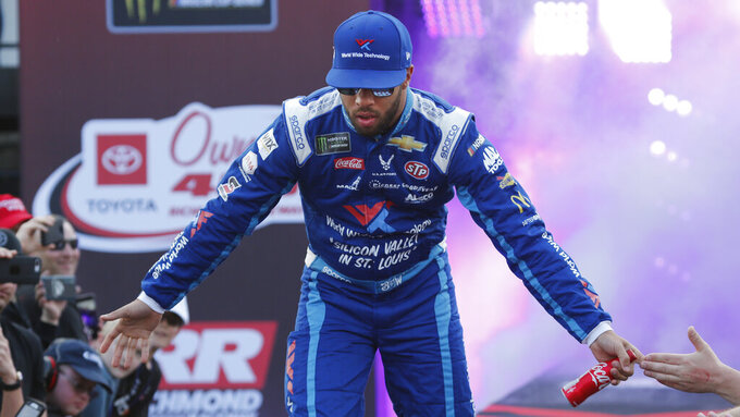 Bubby Wallace greets fans during driver introductions prior to the start of the NASCAR Cup series auto race at Richmond Raceway in Richmond, Va., Saturday, April 13, 2019. (AP Photo/Steve Helber)