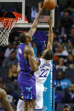 Golden State Warriors forward Glenn Robinson III (22) shoots as Charlotte Hornets center Bismack Biyombo defends during the first half of an NBA basketball game in Charlotte, N.C., Wednesday, Dec. 4, 2019. (AP Photo/Nell Redmond)