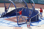 Boston Red Sox's J.D. Martinez swings in the batting cage during baseball training camp at Fenway Park, Tuesday, July 7, 2020, in Boston. (AP Photo/Elise Amendola)