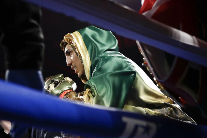 FILER  - In this April 20, 2019, file photo, Teofimo Lopez is shown before an NABF lightweight championship boxing match against Finland's Edis Tatli, in New York. Brooklyn-born Teofimo Lopez stunned Vasiliy Lomachenko on Saturday, Oct. 17, 2020, to win a unanimous 12-round decision and unify the lightweight titles to join a rare group of boxers of Central American descent to capture a world championship. (AP Photo/Frank Franklin II, File)