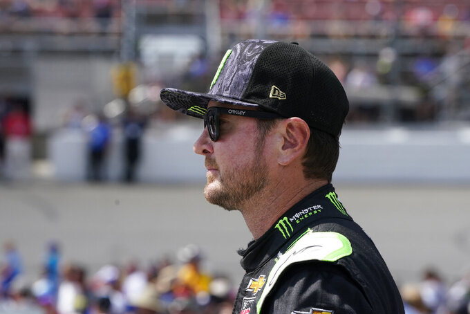 Kurt Busch talks with other drivers before driver introductions at the NASCAR Cup Series auto race at Michigan International Speedway, Sunday, Aug. 22, 2021, in Brooklyn, Mich. (AP Photo/Carlos Osorio)