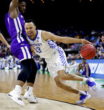 Kentucky's Jemarl Baker Jr. (13) makes a move to get past Abilene Christian's Jaylen Franklin during the first half of a first-round game in the NCAA men's college basketball tournament in Jacksonville, Fla. Thursday, March 21, 2019. (AP Photo/John Raoux)