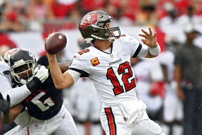 Tampa Bay Buccaneers quarterback Tom Brady (12) fires a pass against the Atlanta Falcons during the first half of an NFL football game Sunday, Sept. 19, 2021, in Tampa, Fla. (AP Photo/Jason Behnken)