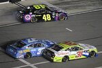 Chris Buescher (37) and Tyler Reddick (31) bump each other on pit road as Jimmie Johnson (48) leaves his stall during the first of two qualifying races for the NASCAR Daytona 500 auto race at Daytona International Speedway Thursday, Feb. 14, 2019, in Daytona Beach, Fla. (AP Photo/Phelan M. Ebenhack)