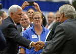 Vice President Mike Pence, left, shakes hands with attendees at Schott Glass Co. in Duryea, Pa., on Monday, Oct. 21, 2019, after speaking about President Donald Trump's economic achievements and the United States-Mexico-Canada Trade agreement. (Aimee Dilger/The Times Leader via AP)