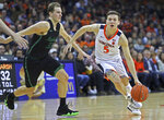 Virginia's guard Kyle Guy (5) drives past Marshall's Jon Elmore (33) during the second half of an NCAA college basketball game on Monday, Dec. 31, 2018, in Charlottesville, Va. Virginia beat Marshall 100-64. (AP Photo/Zack Wajsgras)