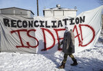 Supporters of the Wet'suwet'en who are against the LNG pipeline, block a Canadian National Railway line just west of Edmonton, Alberta, on Wednesday, Feb. 19, 2020. (Jason Franson/The Canadian Press via AP)