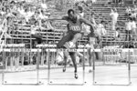 FILE - In this June 21, 1980, file photo, Edwin Moses, gold medal winner in 1976 in Montreal, coasts to an easy victory in the 400 intermediate hurdles as the 1980 Olympic trials in Eugene, Ore,. While the fact that Moses was denied a chance at a medal in 1980 is only a footnote to his career, he has spent the last several months organizing reunions for the 1980 team.  (AP Photo/File)