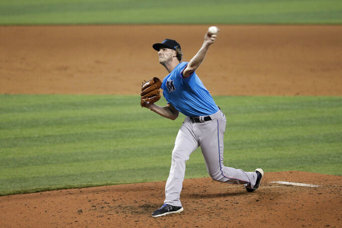Miami Marlins' Adam Conley pitches during a baseball workout at Marlins Park, Tuesday, July 14, 2020, in Miami. (AP Photo/Wilfredo Lee)