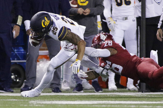 Washington State defensive back Hunter Dale (26) tackles California wide receiver Nikko Remigio (25) during the second half of an NCAA college football game in Pullman, Wash., Saturday, Nov. 3, 2018. Washington State won 19-13. (AP Photo/Young Kwak)