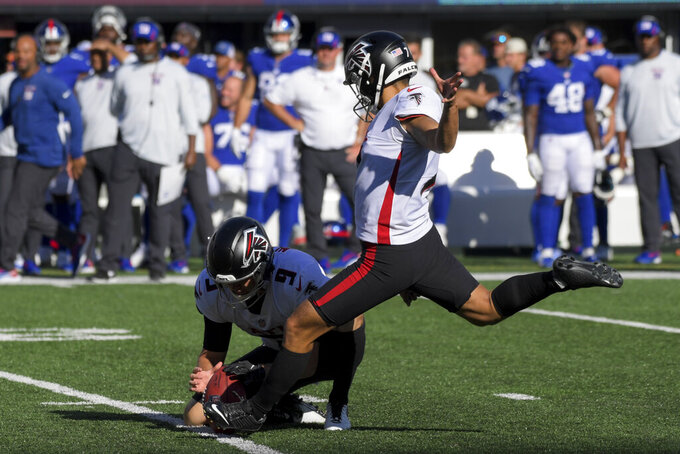 Atlanta Falcons kicker Younghoe Koo kicks the game-winning field goal during the second half of an NFL football game against the New York Giants, Sunday, Sept. 26, 2021, in East Rutherford, N.J. (AP Photo/Bill Kostroun)