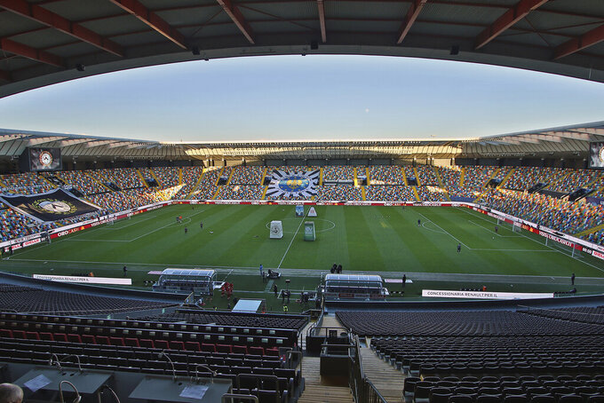 A view of the empty Dacia Arena stadium in Udine, Northern Italy, prior to the Italian Serie A soccer match between Udinese and Fiorentina, Sunday, March 8, 2020. Serie A played on Sunday despite calls from Italy's sports minister and players' association president to suspend the games in Italy's top soccer division. (Andrea Bressanutti/LaPresse via AP)