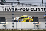 Clint Bowyer (14) drives past a message about his last season during a NASCAR Cup Series auto race at Kansas Speedway in Kansas City, Kan., Sunday, Oct. 18, 2020. (AP Photo/Orlin Wagner)
