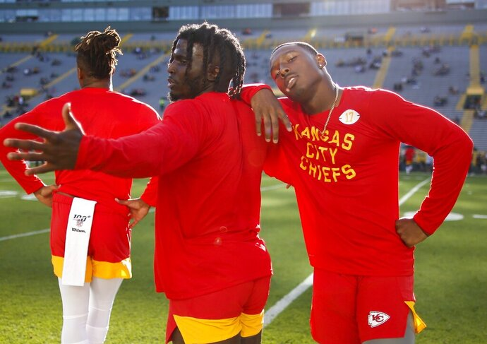 Kansas City Chiefs' Tyreek Hill and Mecole Hardman have some fun before a preseason NFL football game Thursday, Aug. 29, 2019, in Green Bay, Wis. (AP Photo/Matt Ludtke)