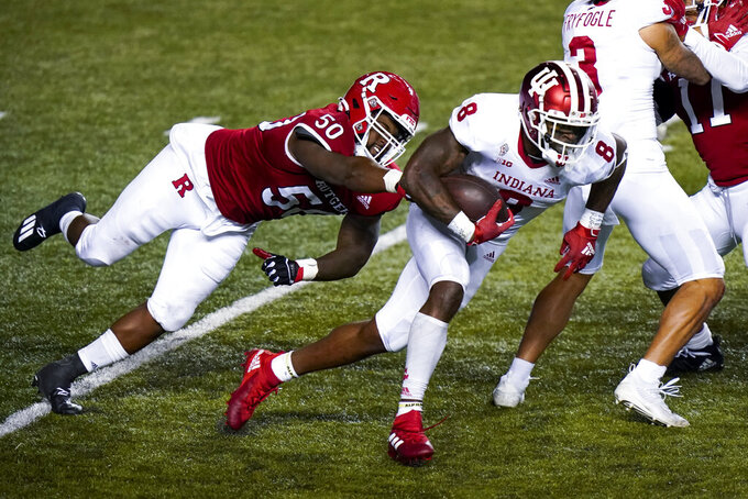 Rutgers defensive lineman Julius Turner (50) pursues Indiana running back Stevie Scott III (8) during the fourth quarter of an NCAA college football game Saturday, Oct. 31, 2020, in Piscataway, N.J. (AP Photo/Corey Sipkin)