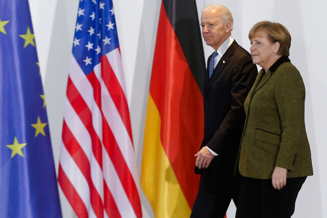 File---File picture taken Friday, Feb. 1, 2013 shows German Chancellor Angela Merkel, right, and United States' Vice President Joe Biden at the chancellery in Berlin, Germany.   (AP Photo/Markus Schreiber,file)