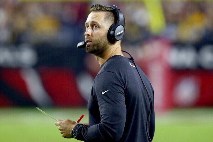 Arizona Cardinals head coach Kliff Kingsbury watches the clock during the first half of an NFL football game against the Pittsburgh Steelers, Sunday, Dec. 8, 2019, in Glendale, Ariz. (AP Photo/Ross D. Franklin)