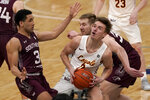 Loyola of Chicago's Paxson Wojcik (0) heads to the basket as Southern Illinois' Dalton Banks (3) and Anthony D'Avanzo defend during the second half of an NCAA college basketball game in the quarterfinal round of the Missouri Valley Conference men's tournament Friday, March 5, 2021, in St. Louis. (AP Photo/Jeff Roberson)