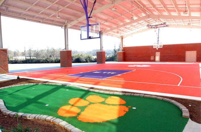 This Jan. 31, 2017 photo, shows a miniature golf course and outdoor basketball court at the Clemson Football Facility at Clemson University in Clemson, S.C. When it comes to facilities in the ACC, Clemson has set the standard.  The Tigers opened a $55 million team headquarters two years ago that includes a miniature golf course, a slide and a nap room. With the team pursuing its fourth straight ACC title and College Football Playoff berth, they feel the investment is paying off. (Ken Ruinard/The Independent-Mail via AP)